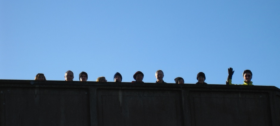 Photo : group members waving from railway Bridge